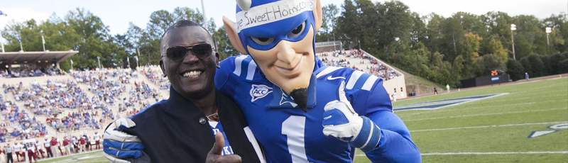 "<h3>FIRST BLACK BLUE DEVIL</h3><p>Michael Holyfield, T'79, the first black Blue Devil mascot, returned to campus during homecoming weekend when he was recognized with a letterman's jacket for his service to Duke.</p><div class=""more_button""> <a href=""http://today.duke.edu/2013/09/holyfield"" target=""_blank""> </a> </div>"
